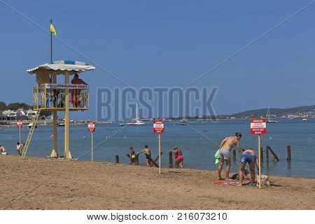 Gelendzhik, Krasnodar region, Russia - 16 July 2015: Vacationers people ignore the warning signs that says