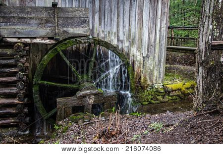 Vintage Wooden Water Wheel. Historic pioneer wooden waterwheel with water flowing over it. Great Smoky Mountains National Park. Gatlinburg, Tennessee.