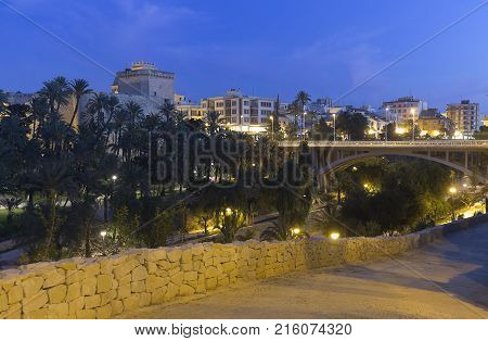 Views of the city of Elche dusk. In the image are the Altamira Palace the Basilica of Santa Maria and the Altamira bridge.