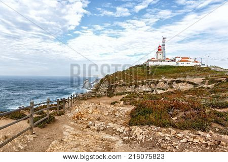 Roca cape lighthouse in Portugal, West most point of Europe, Cabo da Roca, Portugal. Side view of the cape without tourists