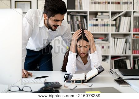 Angry boss yelling at his employee in office for mistakes in work