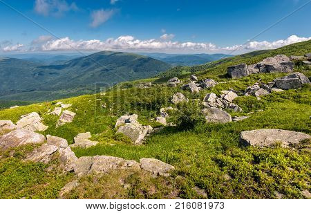 Giant Boulders On A Grassy Slope