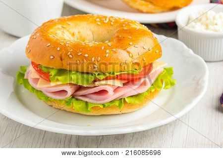 Bagel Sandwich With Ham, Cheese, Tomato, Green Salad Lettuce, Tea, Tatsy Breakfast
