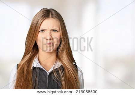 Young woman sceptic young adult white background view