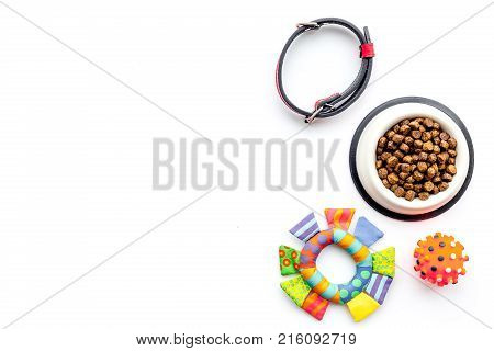 Concept pet care, playing and training. Toys, accessories and feed on white background top view.