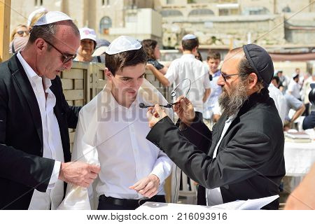Jerusalem Israel - April 2017: Bar Mitzvah Ritual At The Wesern Wall In Jerusalem Israel.boy Who Has