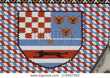ZAGREB, CROATIA - AUGUST 19: Coat of Arms Kingdom of Croatia, Slavonia and Dalmatia, checkered tiled rooftop of St Mark's church in Zagreb, Croatia on August 19, 2017.