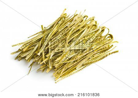 Green soybean fettuccine isolated on white background. Gluten Free, high fibre pasta.