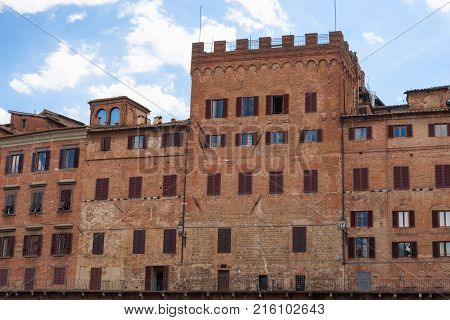 SIENA, ITALY - MAY 25, 2017: Piazza del Campo.The historic centre of Siena has been declared by UNESCO a World Heritage Site. Beautiful historic buildings and palaces.