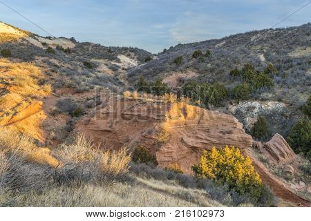 Sunset light over arroyo and single track trail (Salt Lick) in Red Mountain Open Space in northern Colorado l