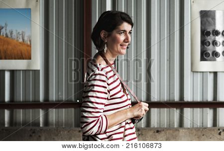 An Adult Woman With Camera Capturing Snapshot Outdoor