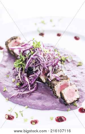 Modern fusion gourmet food cuisine seared tuna fish meal with beetroot sauce