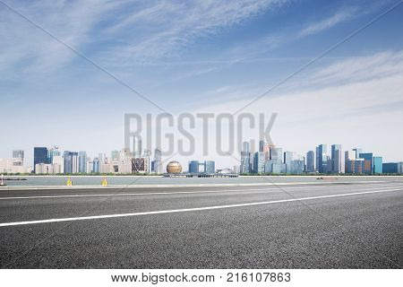 empty asphalt road and cityscape of hangzhou qianjiang new city in blue cloud sky
