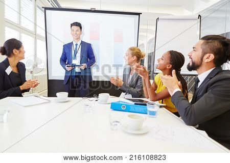 Business team clapping after speaker's successful presentation