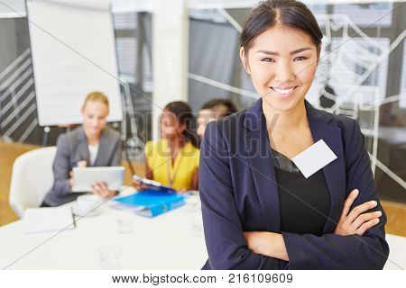 Young asian woman as business consultant with start-up team