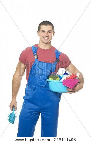 Young man with cleaning supplies on white background