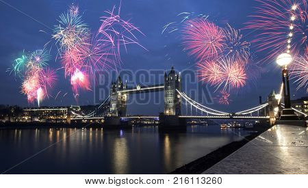 Tower Bridge with fireworks - celebration of the New Year in London, United Kingdom