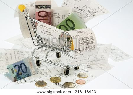shopping cart, receipts and money