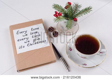 Merry Christmas greetings or wishes - Handwritten text with wishes on a napkin - Every time we love every time we give its Christmas