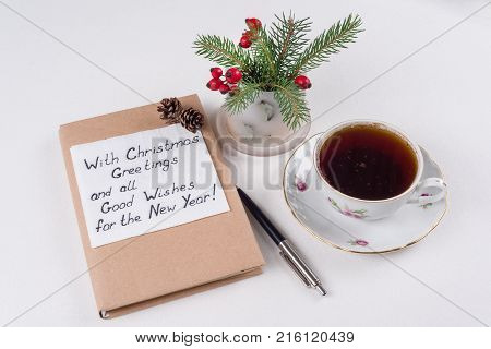 Merry Christmas greetings or wishes - Handwritten text with wishes on a napkin - With Christmas greetings and all good wishes for the New Year