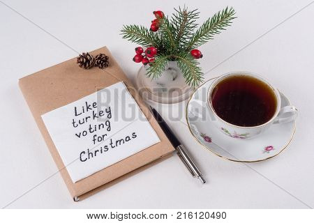 Merry Christmas greetings or wishes - Handwritten text with wishes on a napkin - Like turkey voting for Christmas