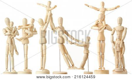 12 wooden figures of parents and children, full body, isolated on white, collage