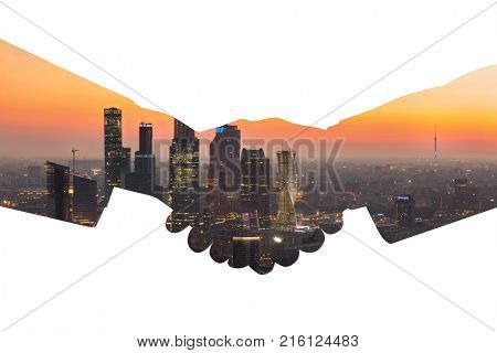 Silhouette of handshake with city panorama with skyscrapers during sunset, collage