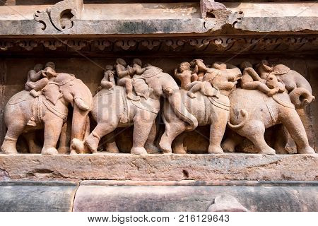 Famous erotic bas relieves, Lakshmana Temple, Khajuraho, India. Unesco World Heritage Site. The most famous landmark in India. Temple of love. Kama Sutra