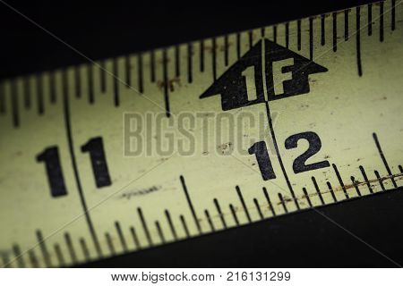 Close up macro shot of measuring tape for construction one foot