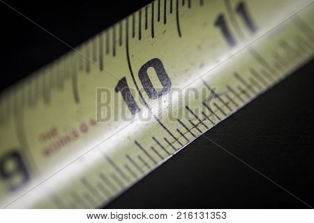 Close up macro shot of measuring tape for construction
