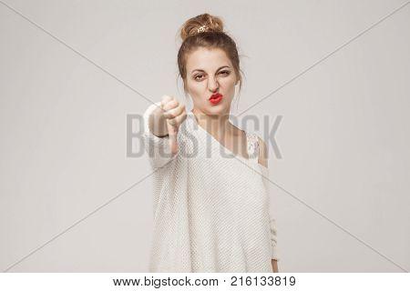 Bad Sign. Woman Demonstrate Dislike At Camera