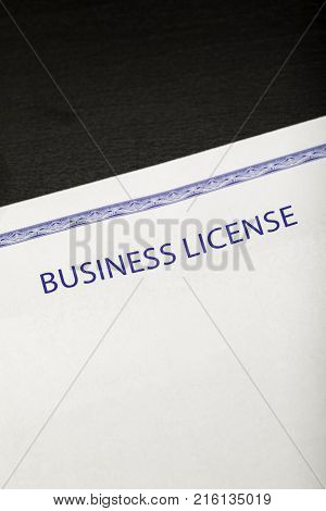 Business license on a black desk macro shot