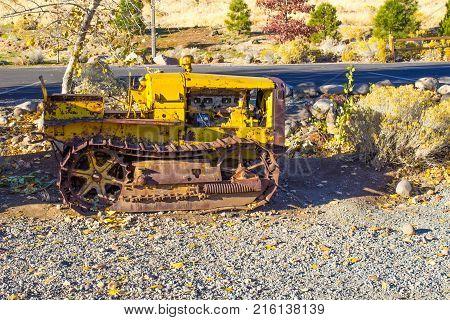 Vintage Yellow Mini Bulldozer With Unique Iron Treads