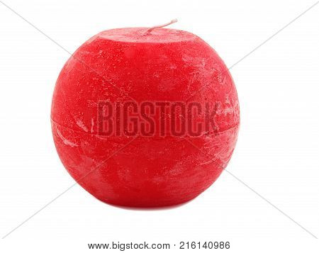 Red, bright, round wax candle with a wick is isolated on a white background