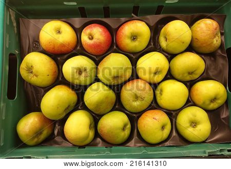 Bramley cooking apples on display in a shop