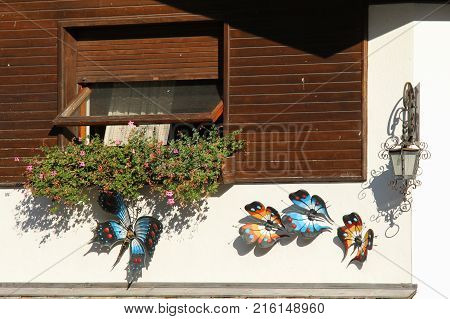 Italy Rocca Pietore - August 26 2016: the view of the decorative ironwork sculpture butterflies on a wall on August 26 2016 Veneto Italy.
