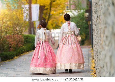 Asian Korean woman dressed Hanbok in traditional dress walking in Jeongdong-gil in Seoul South Korea.