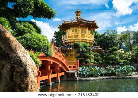 Front view the Golden pavilion temple with red bridge in Nan Lian garden Hong Kong. Asia.