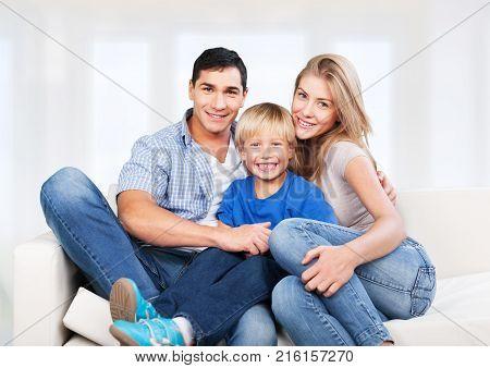 Happy family son elementary age pre-adolescent child green fun