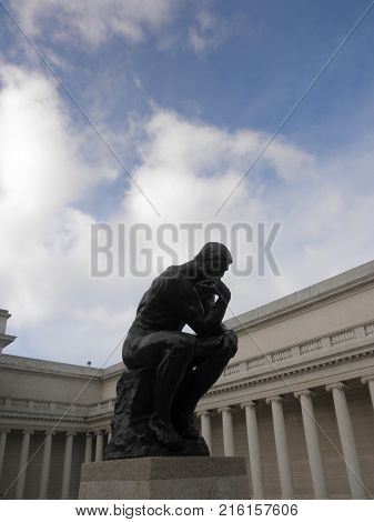 San Francisco - November 5 2009: profile of the masterpiece the Thinker by Rodin - The Thinker at the entrance of the Palace of the Legion of Honor in San Francisco.
