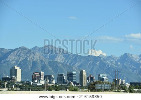 SALT LAKE CITY, UT - AUG 30: View of Salt Lake City in Utah, as seen on Aug 30, 2017. The city is bordered by the buoyant waters of the Great Salt Lake and the snow-capped peaks of the Wasatch Range.