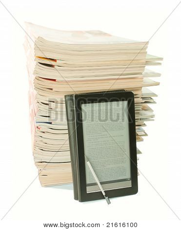 Electronic Book With A Stack Of Old Newspapers Behind On White Background