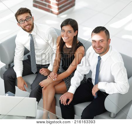 friendly business team sitting in office lobby