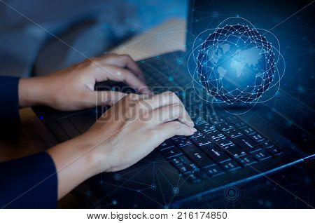 Press enter button on the computer. business logistics Communication network World map send message Connect worldwide hand keyboard Communications network map of the world Blue map Dark blue background map world global logistics network