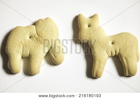 Animal cracker shot close up against a white background elephant and donkey republican and democrat political politics