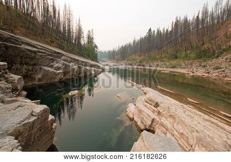 Meadow Creek Gorge in the Bob Marshall Wilderness complex during the 2017 fall forest fires in Montana United States poster