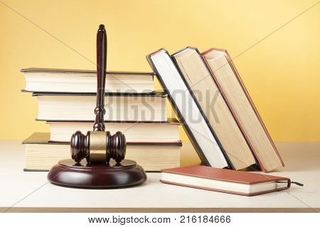 Law concept. Book with wooden judge gavel on table in a courtroom or enforcement office