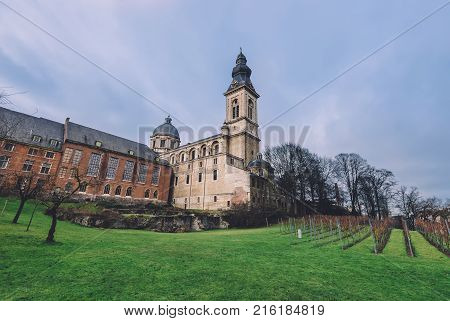 January, 3th, 2017 - Ghent, East Flanders, Belgium. Catholic hurch of Our Lady and St. Peter, vineyard and Benedictine abbey in Gent also known as Sint-Baafsabdij by sunny day.