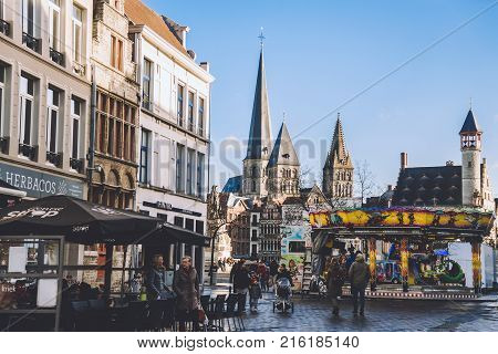 January, 2th, 201 -Ghent, East Flanders, Belgium. Sint-Jacobs gothic church, carousel and christmas fair decorations during winter festival. Saint Jacob cathedral is famous historic monument in Gent.