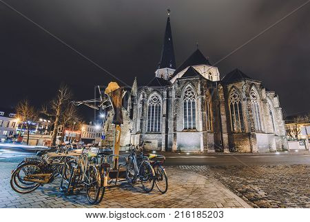 January, 3th, 2017 - Ghent, East Flanders, Belgium. Night view of gothic Saint James church also known as Sint-Jacobskerk or St. Jacob cathedral by illumination. Popular Gent architectural landmark.